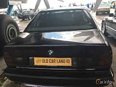 Back of BMW 5 Series Sedan 1994 at Old Car Land no.1 2019