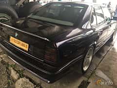 Back/Side of BMW 5 Series Sedan 1994 at Old Car Land no.1 2019