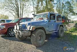 Front/Side  of Jeep Wrangler 4.0 V6 4WD Manual, 177ps, 1997 at Lissma Classic Car 2019 vecka 20