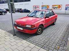 Front/Side  of Mazda 323 Sedan 1.3 Manual, 73ps, 1994
