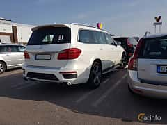 Back/Side of Mercedes-Benz GL 63 AMG 5.5 V8 4MATIC AMG-SpeedShift Plus 7G-Tronic, 557ps, 2015