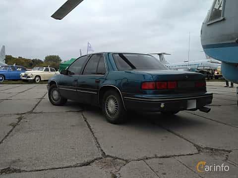 Back/Side of Chevrolet Lumina 3.1 V6 Automatic, 137ps, 1990 at Old Car Land no.2 2017