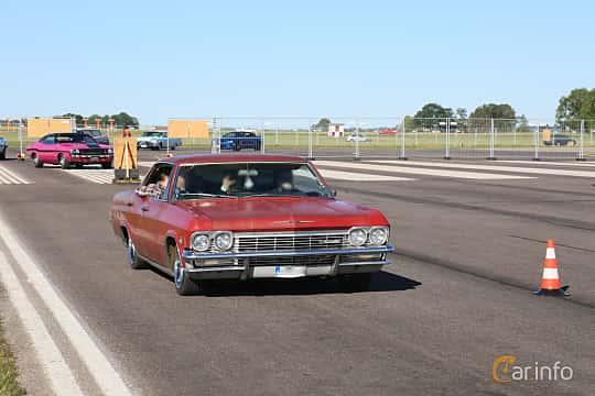 Front/Side  of Chevrolet Impala Sport Sedan 4.6 V8 Powerglide, 198ps, 1965 at Lidköping Power Big Meet  2019
