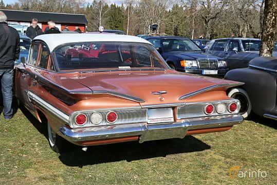 Back/Side of Chevrolet Impala Sedan 3.9 Manual, 137ps, 1960 at Uddevalla Veteranbilsmarknad Backamo, Ljungsk 2019