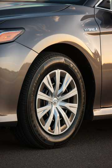 Close-up of Toyota Camry Hybrid 2.5 CVT, 203hp, 2018